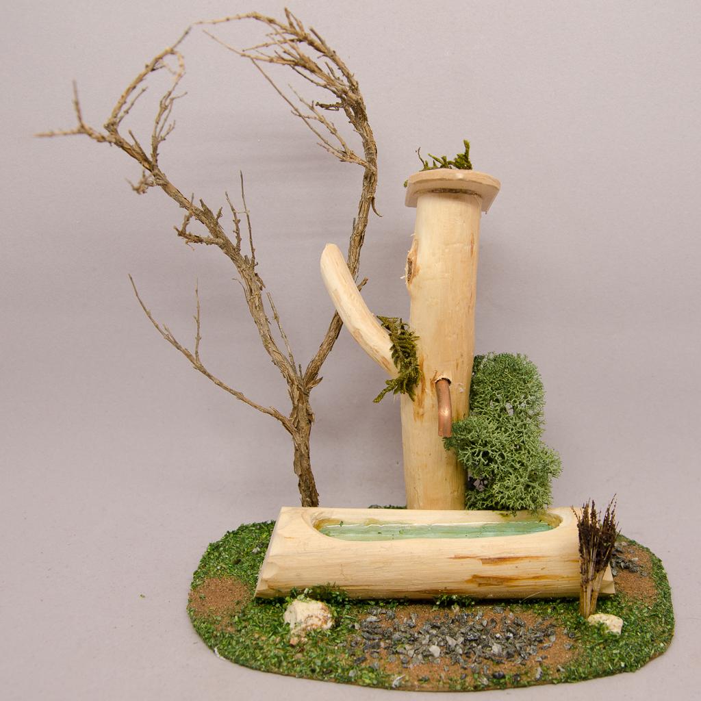 Almtränke mit Baum
